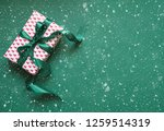 christmas gift box with green...   Shutterstock . vector #1259514319