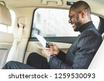 young businessman using tablet... | Shutterstock . vector #1259530093