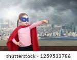 superhero kid against urban... | Shutterstock . vector #1259533786
