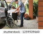 helpful male nurse with senior... | Shutterstock . vector #1259539660