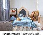 grey pouf on carpet in child's... | Shutterstock . vector #1259547406
