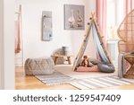 patterned pouf on carpet next... | Shutterstock . vector #1259547409