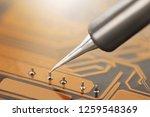 work in progress. soldering of... | Shutterstock . vector #1259548369