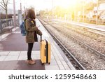 girl tourist with a backpack... | Shutterstock . vector #1259548663