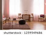 wooden table and pouf on carpet ... | Shutterstock . vector #1259549686
