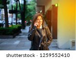 a smiling mature woman in a... | Shutterstock . vector #1259552410