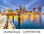 Stock photo boston massachusetts usa downtown city skyline from the harbor at dusk 1259553736