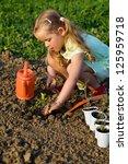 little girl planting tomato... | Shutterstock . vector #125959718