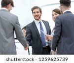 business people shaking hands ... | Shutterstock . vector #1259625739
