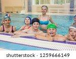 children love being in the pool.... | Shutterstock . vector #1259666149
