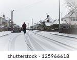 A Cyclist On A Snowy...