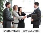 close up. handshake business... | Shutterstock . vector #1259669983