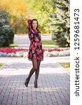 happy young beautiful woman... | Shutterstock . vector #1259681473