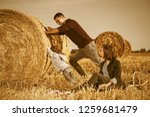 happy young father and his two... | Shutterstock . vector #1259681479