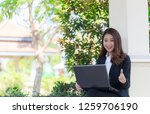 beautiful girl with laptop to... | Shutterstock . vector #1259706190