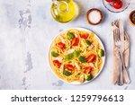 plate of spaghetti tomato... | Shutterstock . vector #1259796613