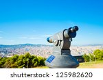 Telescope look at the city Barcelona. Spain - stock photo