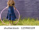 cute little girl with curly... | Shutterstock . vector #125983109