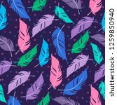 seamless pattern with feathers. ...   Shutterstock .eps vector #1259850940