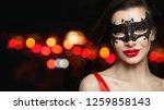 beautiful woman in carnival... | Shutterstock . vector #1259858143