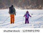 dad and daughter go cross... | Shutterstock . vector #1259891590