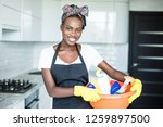 Smiling African Woman Holding...