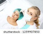 professional beautician doing... | Shutterstock . vector #1259907853