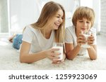 family drinking milk   | Shutterstock . vector #1259923069