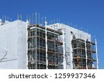 scaffolding with plastic shades | Shutterstock . vector #1259937346