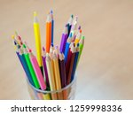 color pencils is in a glass on...   Shutterstock . vector #1259998336