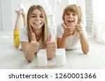 family drinking milk   Shutterstock . vector #1260001366
