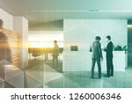 businessmen in interior of... | Shutterstock . vector #1260006346