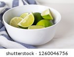 lime in white plate close up on ... | Shutterstock . vector #1260046756