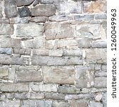 stone wall texture background | Shutterstock . vector #1260049963