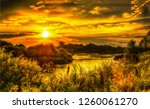 orange sunset rural river... | Shutterstock . vector #1260061270