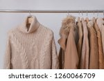 a hanger with knitted sweaters... | Shutterstock . vector #1260066709