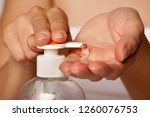 putting sanitizer on hand from... | Shutterstock . vector #1260076753