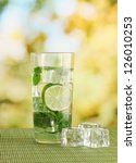 glass of water with ice  mint... | Shutterstock . vector #126010253