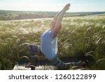girl doing yoga on a beautiful...   Shutterstock . vector #1260122899