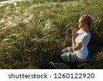 girl meditates sitting on a...   Shutterstock . vector #1260122920