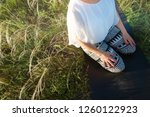 girl meditates sitting on a...   Shutterstock . vector #1260122923