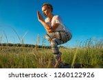 girl doing yoga on a beautiful...   Shutterstock . vector #1260122926