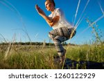 girl doing yoga on a beautiful...   Shutterstock . vector #1260122929