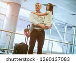 father holding daughter on... | Shutterstock . vector #1260137083
