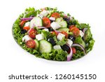 fresh greek salad in plate with ... | Shutterstock . vector #1260145150