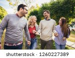 group of young people walking... | Shutterstock . vector #1260227389