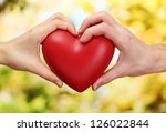 red heart in woman and man... | Shutterstock . vector #126022844