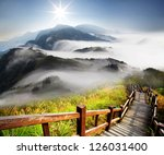 dramatic clouds with mountain... | Shutterstock . vector #126031400