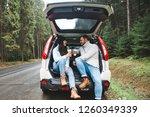 couple stop to drink hot tea.... | Shutterstock . vector #1260349339