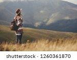 stylish hipster girl in hat... | Shutterstock . vector #1260361870